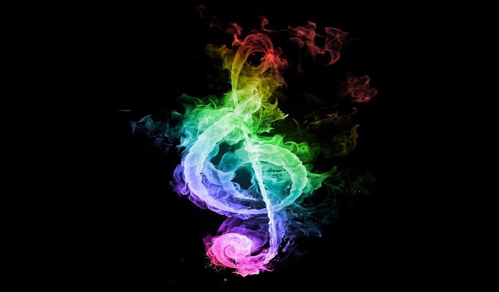 Note de musique en flamme multicolore